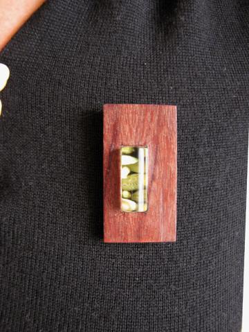 Pendant and Brooch Purpleheart wood with Emerald Nerites. : $80