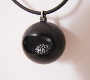 Pendant Ebony with Loose rolling Zebra shell in resin sphere : $160