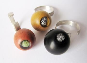 Contemporary Ring Sphere Ebony and Zebra shell magnified : $117